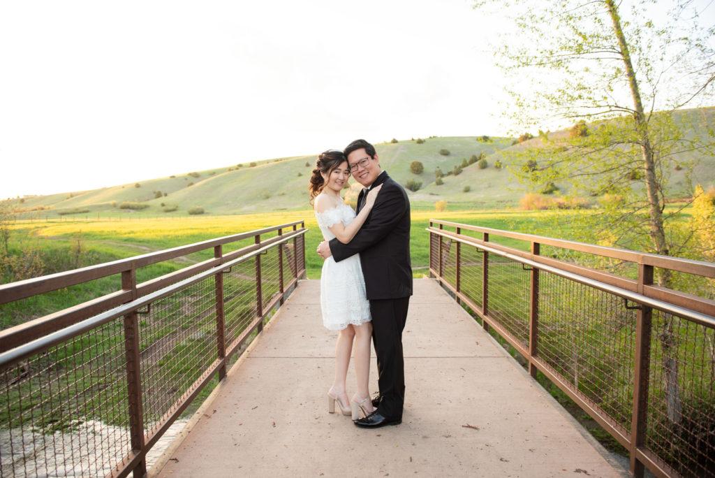 Couple on bridge in formalwear