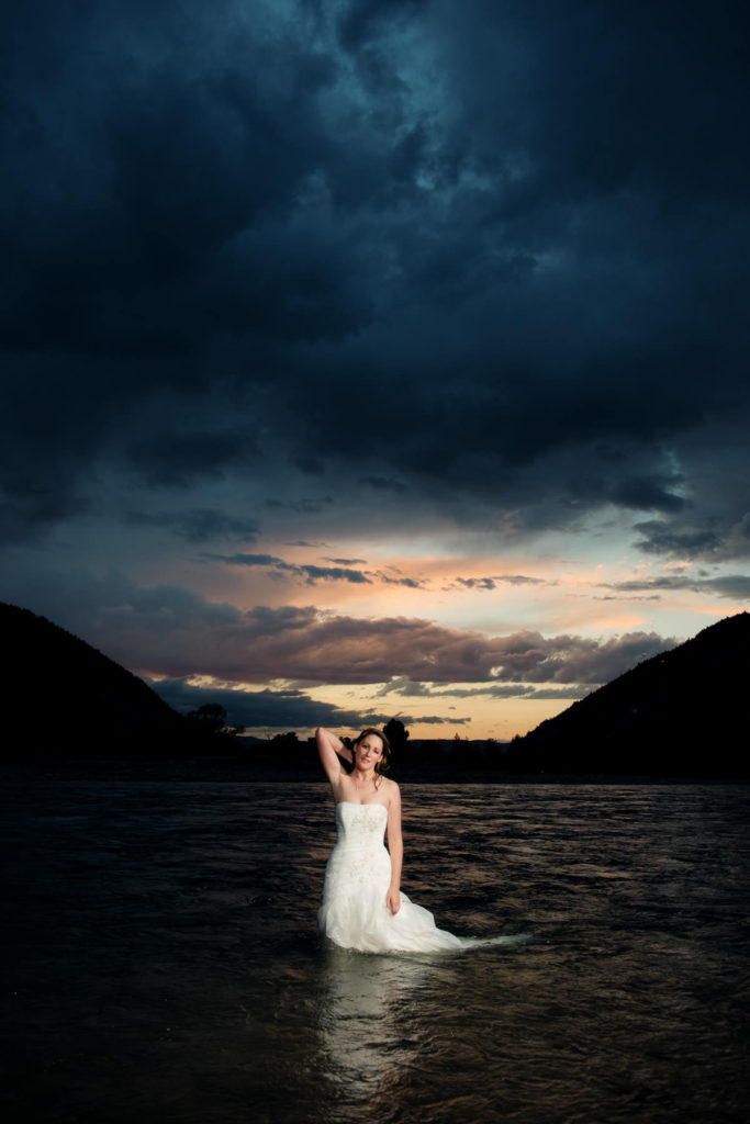 Bride in the water wearing her dress