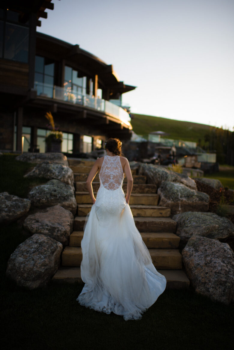 Bride walking up stairs after wedding